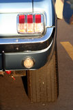 Mustang taillight. A classic car Mustang back end with tail light, fender, and tire Stock Photography