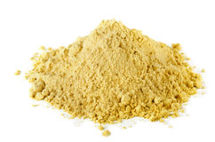 Mustard. Pile of dry mustard powder spice on white royalty free stock photography