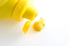 Mustard. A photo of a container of mustard over a white background Stock Image