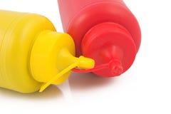 Mustard. Ketchup and mustard bottles Stock Photos