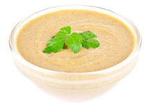Mustard in bowl and parsley Royalty Free Stock Images