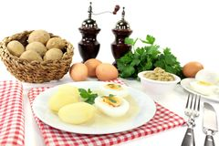 Mustard eggs with potatoes and parsley Royalty Free Stock Photography