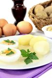 Mustard eggs with potatoes and parsley Stock Images