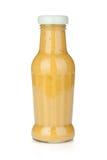 Mustard glass bottle. Isolated on white background Stock Photo