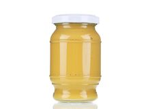 Mustard glass bottle. Isolated on a white background Royalty Free Stock Image