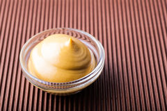 Mustard in a glass bowl close-up Royalty Free Stock Photos