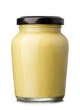 Mustard. Glass jar of mustard  on the white background Stock Photos