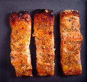 Mustard and honey glazed baked salmons fillet Stock Photos