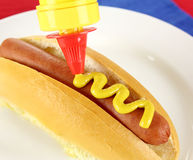 Mustard On Hot Dog Stock Photo
