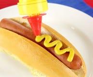 Mustard On Hot Dog Stock Photo