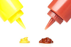 A mustard and ketchup bottle. Against a white background Stock Photos