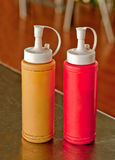 Mustard and ketchup bottle. On dining table Stock Image