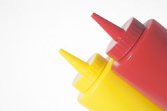 Mustard and Ketchup Bottles. Pair of restaurant style mustard and ketchup bottles stock image