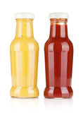 Mustard and ketchup glass bottles Stock Photo