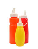 Mustard and ketchup squirt bottles isolated Royalty Free Stock Photo