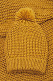 Mustard knitted wool hat and scarf Stock Photo