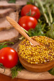 Mustard with wooden spoon Royalty Free Stock Photo