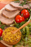 Mustard with meat and herbs Royalty Free Stock Photography