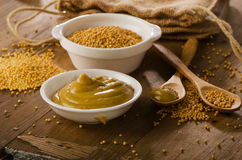Free Mustard On A Old Wooden Table Stock Image - 54098141