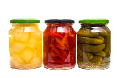 Mustard, paprika and gherkin pickles in a glass Stock Photo