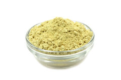 Mustard powder in a glass stock images