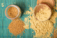 Mustard powder and seeds Royalty Free Stock Photos