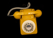 Mustard retro style telephone Royalty Free Stock Photo