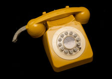 Mustard retro style telephone Royalty Free Stock Image