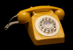 Mustard retro style telephone Royalty Free Stock Photography