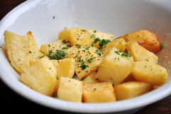 Mustard roast potatoes. A bowl of mustard roasted potatoes with garnish Royalty Free Stock Photography
