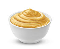 Mustard sauce in bowl isolated on white background. One of the collection of various sauces Royalty Free Stock Photos