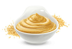 Mustard sauce and seeds isolated on white royalty free stock image