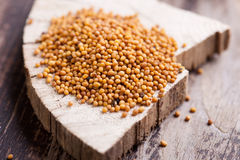 Mustard seeds. On wooden background Stock Photo