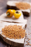 Mustard seeds. On wooden background Royalty Free Stock Image