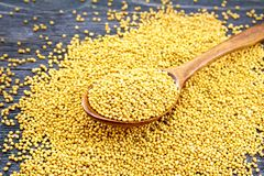 Mustard seeds in spoon on board Stock Images