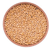 Mustard seeds in wooden bowl Royalty Free Stock Photo