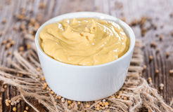 Mustard in a small bowl Royalty Free Stock Image