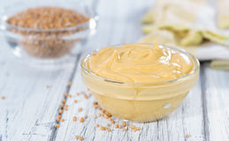 Mustard in a small bowl Stock Photography