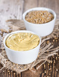 Mustard (on wooden background) Stock Photo