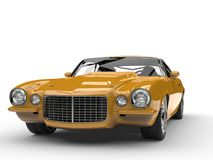Mustard yellow old school vintage American car - front view. Isolated on white background Royalty Free Stock Photography