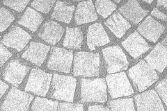 Muster auf der gepflasterten Straße Lizenzfreie Stockfotografie
