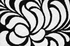 Muster auf gesponnenem Gewebe Stockfoto