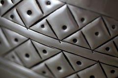 Muster auf Metalloberfläche Stockbild