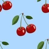 Muster der großen roten Kirsche mit Blättern auf blauem Hintergrund Stockfotos