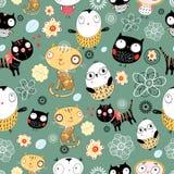 Muster der Katzen und der Eulen Stockfoto