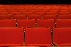 Muster der leeren roten Sitze Lizenzfreie Stockbilder