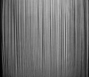 Muster der Stahlgestänge gegen eine raue Wand - lizenzfreie stockfotos