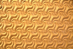 Muster geschnitzt auf hölzernem Sperrholzhintergrund Stockbild