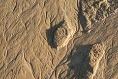 Muster gezeichnet auf den Sand Stockbilder