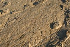 Muster gezeichnet auf den Sand Stockbild